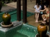 Foundry Instructor Andrea Bruce works with a student poolside in Chiang Mai. Courtesy, © Suzie Katz 2012