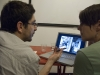 Walter Astrada works with a student on Portfolio Review Night. Courtesy, © Suzie Katz 2012