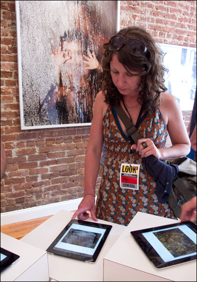 Viewers can learn more about photographers work and visit with other Festival-goers in the process. Courtesy, © Susan Katz 2011