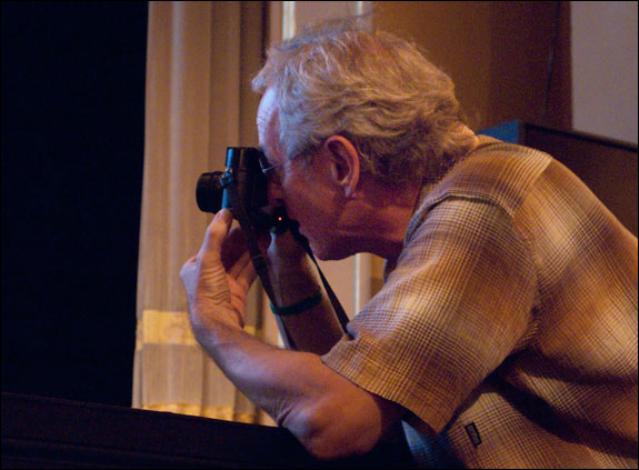 "LOOK3 pioneer, Michael ""Nick"" Nichols documents a fellow photographer on stage. Courtesy, © Susan Katz, 2011"