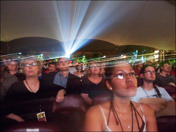 Festival-goers watch the evening presentations in the Pavilion. Courtesy, © Susan Katz 2009