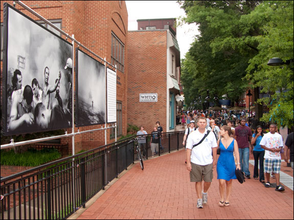 The outdoor exhibitions provide a chance for the community to see images by world renowned photographers. Courtesy, © Susan Katz 2009