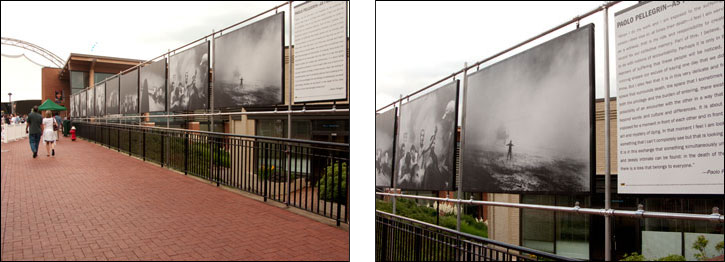 (left) This image shows the walkway toward the Pavilion slide show area. Courtesy, © Susan Katz 2009 (right) The outdoor exhibition by photographer, Paolo Pellegrin displayed at the Free Speech Wall. Courtesy, © Susan Katz 2009