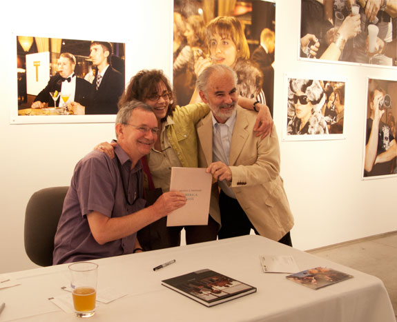 Martin Parr getting his photo taken with John Gossage and a festival-goer. Courtesy, © Susan Katz, 2009