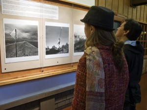 Visitors enjoy looking at Ken Light's photographs