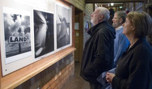 Guests view Ken Light's photographs,