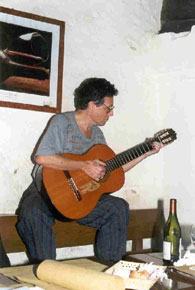 A. D. Coleman strumming a guitar.  2000 by A. D. Coleman. All rights reserved.