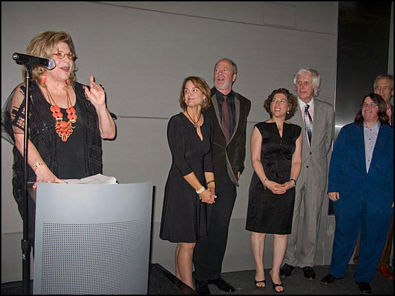 Founder Wallis Annenberg speaks at the inaugural opening while exhibiting photographers, Carolyn Cole, Greg Gorman, Lauren Greenfield, Douglas Kirkland and Catherine Opie, look on. Courtesy, © Susan Katz, 2009